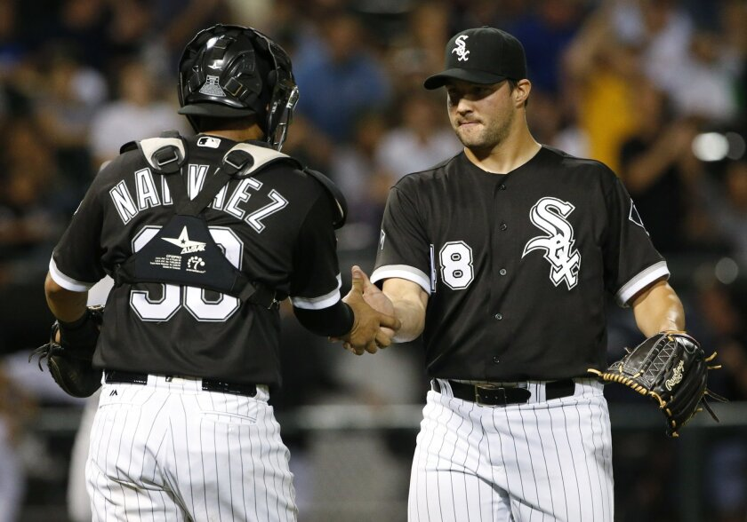 Chicago White Sox relief pitcher Tommy Kahnie, right, celebrates with catcher Omar Narvaez after they defeated the Kansas City Royals in a baseball game Friday, Sept. 9, 2016, in Chicago. (AP Photo/Nam Y. Huh)