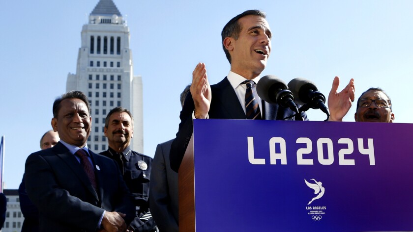 Mayor Eric Garcetti speaks at a news conference after the City Council gave its final approval to a proposal that could bring the 2024 Olympic Games to Southern California in 2024.
