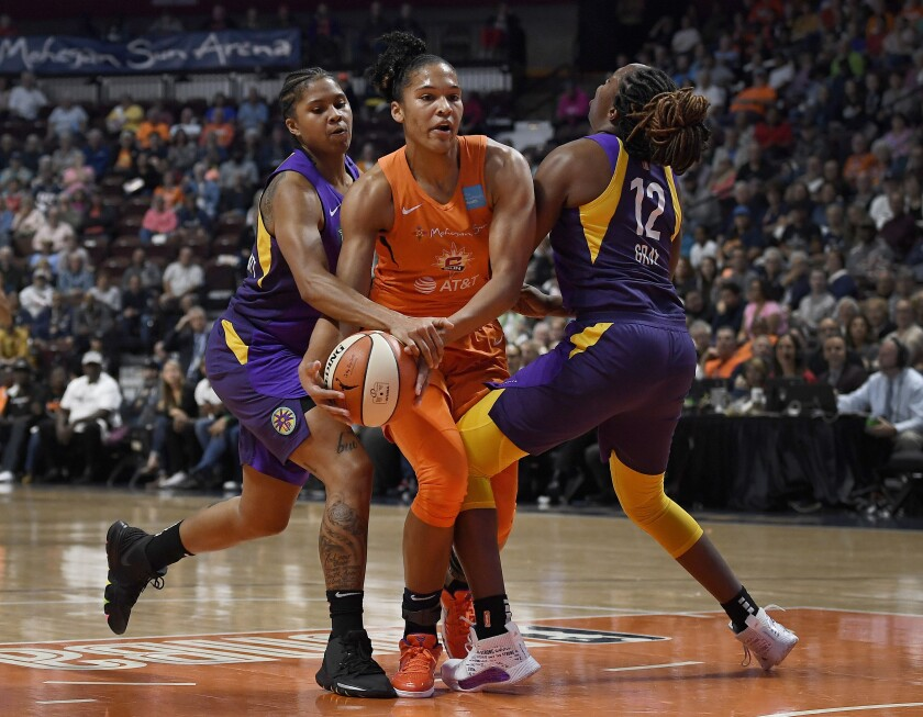 Sparks' Tierra Ruffin-Pratt, left, and Chelsea Gray, right, pressure Connecticut Sun's Alyssa Thomas, center, during the first half of Game 2 of the WNBA semifinals on Thursday.