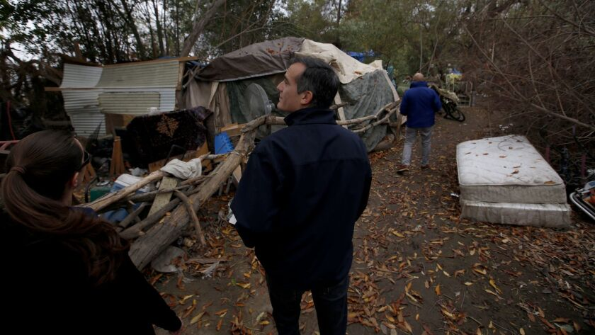 Mayor Eric Garcetti talks with homeless Angelenos at an encampment around the Sepulveda Basin in Encino on Dec. 15, 2016 For L.A. voters, homelessness has eclipsed crime, traffic and schools as the top concern, according to private polls.