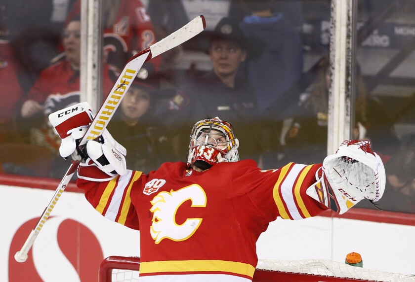 Calgary Flames goalie David Rittich, of the Czech Republic, celebrates the team's 3-1 victory over the Ottawa Senators in the third period of an NHL hockey game Saturday, Nov, 30, 2019, in Calgary, Alberta. (Larry MacDougal/The Canadian Press via AP)