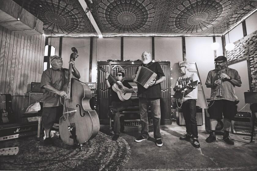 The members of Los Lobos are, from left, bassist Conrad Lozano, guitarist Cesar Rosas, guitarist/accordionist David Hidalgo, guitarist/drummer Louie Pérez and saxophonist/keyboardist Steve Berlin.