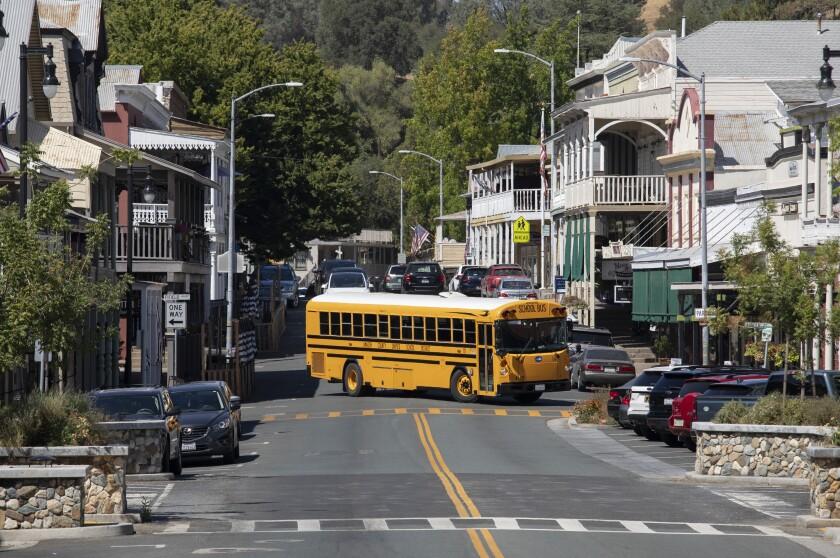 A school bus passes through downtown Sutter Creek, Calif.