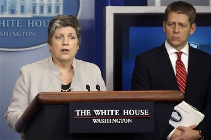 Homeland Security Secretary Janet Napolitano, accompanied by White House press secretary Jay Carney, briefs reporters on the sequester, Monday, Feb. 25, 2013, at the White House in Washington. (AP Photo/Charles Dharapak)