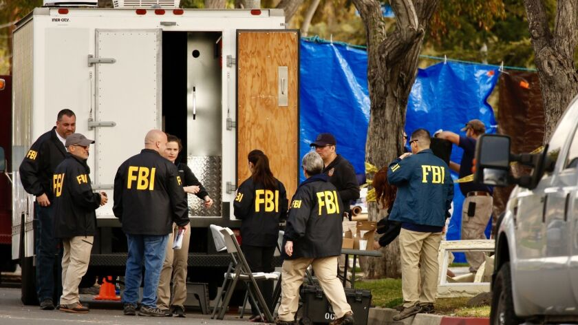 FBI agents search the home of Stephen Beal, who is charged in connection with a fatal blast at an Aliso Viejo day spa that killed his ex-girlfriend, in May 2018.