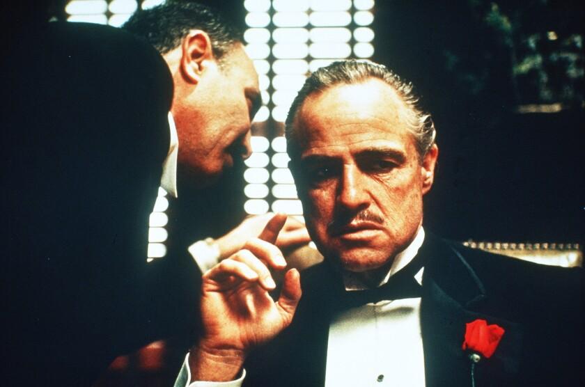 """Marlon Brando, right, heads the cast of the 1972 crime drama """"The Godfather."""" With Salvatore Corsitto."""