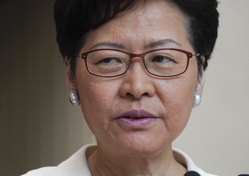 FILE - In this Sept. 17, 2019, file photo, Hong Kong Chief Executive Carrie Lam speaks to reporters' during a press conference at the government building in Hong Kong. Riot police have begun securing a stadium in downtown Hong Kong ahead of a town hall session by city leader Carrie Lam aimed at cooling down months of protests for greater democracy in the semi-autonomous Chinese territory. (AP Photo/Vincent Yu, File)