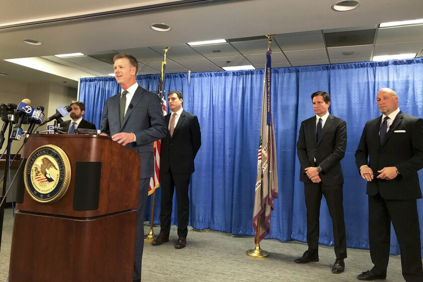 """FILE - In this Sept. 30, 2019, file photo, U.S. attorney David Anderson announces criminal spy charges against San Francisco Bay Area tour operator Xuehua Edward Peng, in San Francisco. Xuehua Edward Peng was sentenced to four years in prison for serving as an unregistered agent for China's ministry of state security in a scheme to use """"dead drops"""" to pick up digital memory cards from a source and take them to China. Xuehua Edward Peng also was sentenced Monday, March 16, 2020, in Oakland, California, federal court to pay a $30,000 fine, the U.S. Justice Department said.(AP Photo/Janie Har, File)"""