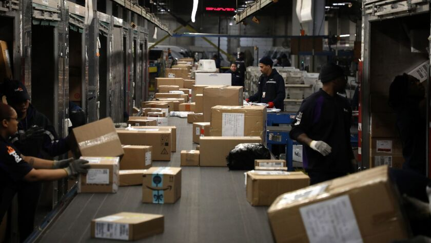 Packages roll through a FedEx Express sorting facility in Chicago this month.