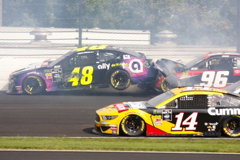 NASCAR driver Jimmie Johnson's car (48) is hit by Parker Kligerman's car (96) in the second turn during the NASCAR Brickyard 400 on Sunday