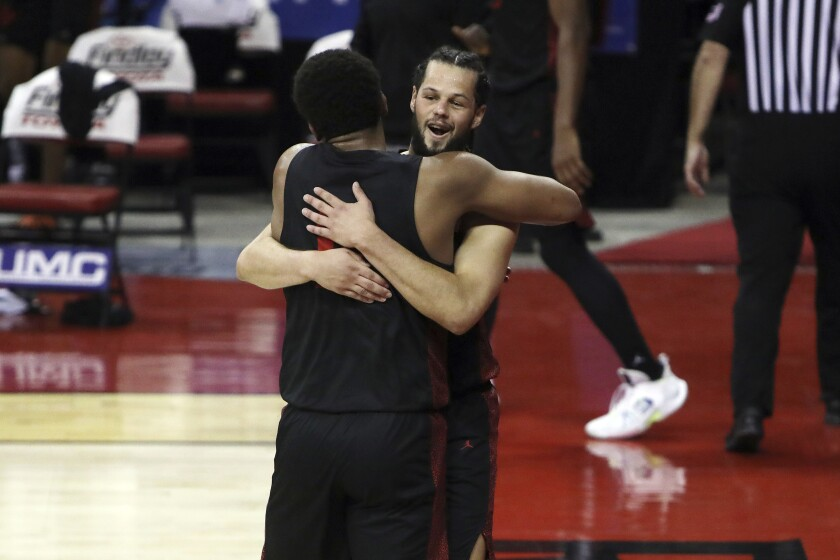 San Diego State's Jordan Schakel (20) and Matt Mitchell (11) celebrate after clinching the Mountain West title at UNLV.
