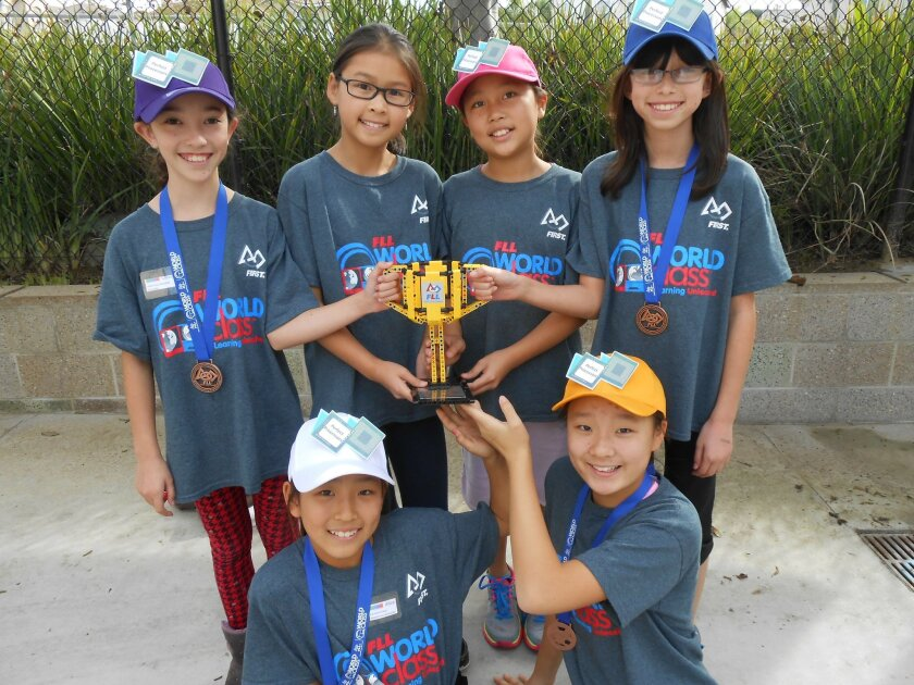 The Perfect Processors, an all- girls team, placed second in the presentation for their innovative way to teach kids about the Order of Operations in Math. The judges felt that this idea could be entered in the Global Innovation Award category. Standing (L-R): Olivia, Amelia, Kelly, Kimmi. Sitting: Alice and Subin