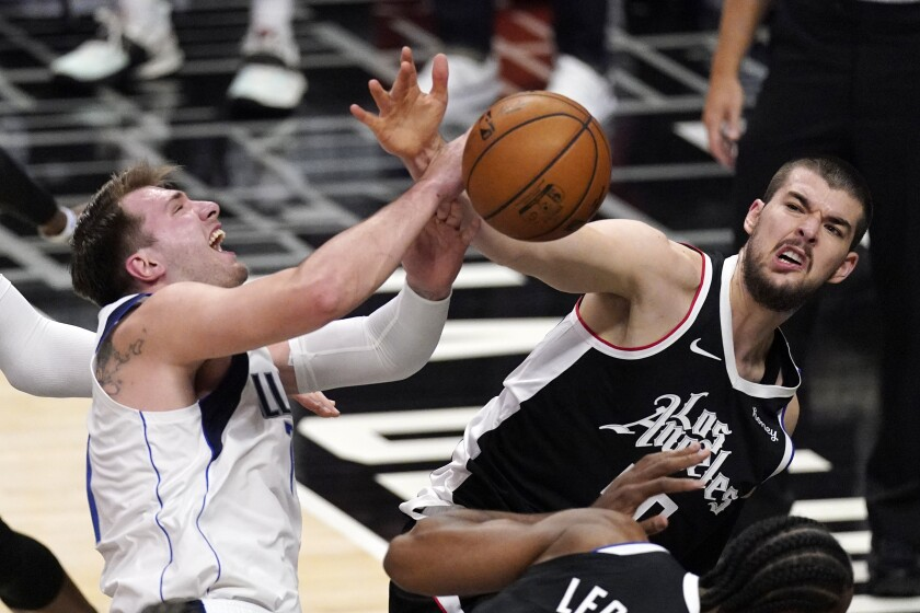 Dallas Mavericks guard Luka Doncic, left, tries to shoots as Los Angeles Clippers center Ivica Zubac defends during the first half in Game 5 of an NBA basketball first-round playoff series Wednesday, June 2, 2021, in Los Angeles. (AP Photo/Mark J. Terrill)
