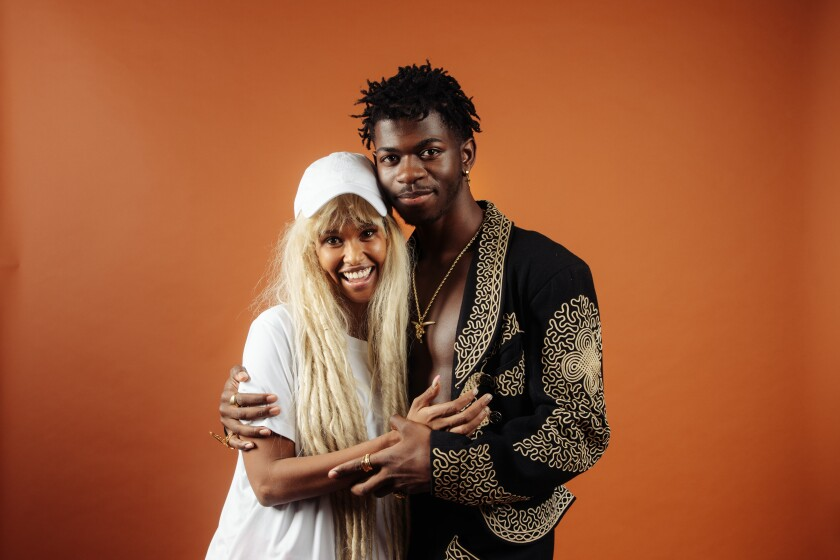Rapper, singer and songwriter Lil Nas X, right, and stylist Hodo Musa.