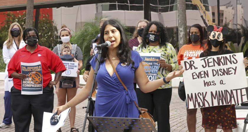 State Rep. Anna Eskamani, D-Orlando, delivers remarks at a protest in front of the Orange County Public Schools headquarters in downtown Orlando, Fla., Monday, Aug. 23, 2021. Teachers, parents and union representatives gathered to demand that the Orange school board adopt a mandatory mask policy because of rising COVID-19 cases, despite an executive order banning school mandates from Florida Gov. Ron DeSantis. (Joe Burbank/Orlando Sentinel via AP)