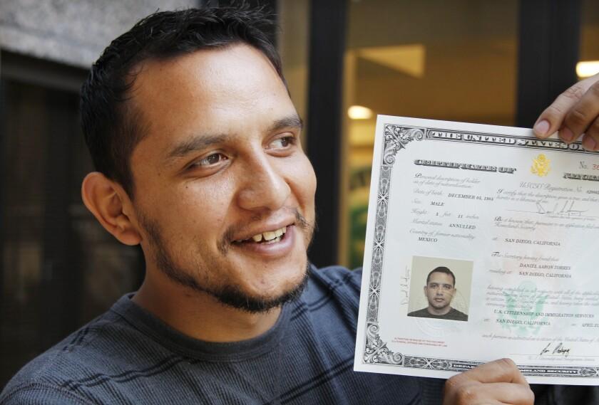 Former United States Marine Daniel Torres leaves a naturalization ceremony.