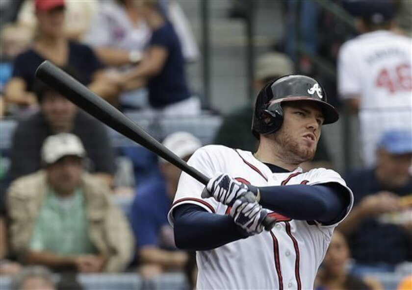 Atlanta Braves first baseman Freddie Freeman (5) follows through with a three-run home run in the second inning of a baseball game against the New York Mets, Monday, Sept. 2, 2013, in Atlanta. (AP Photo/John Bazemore)