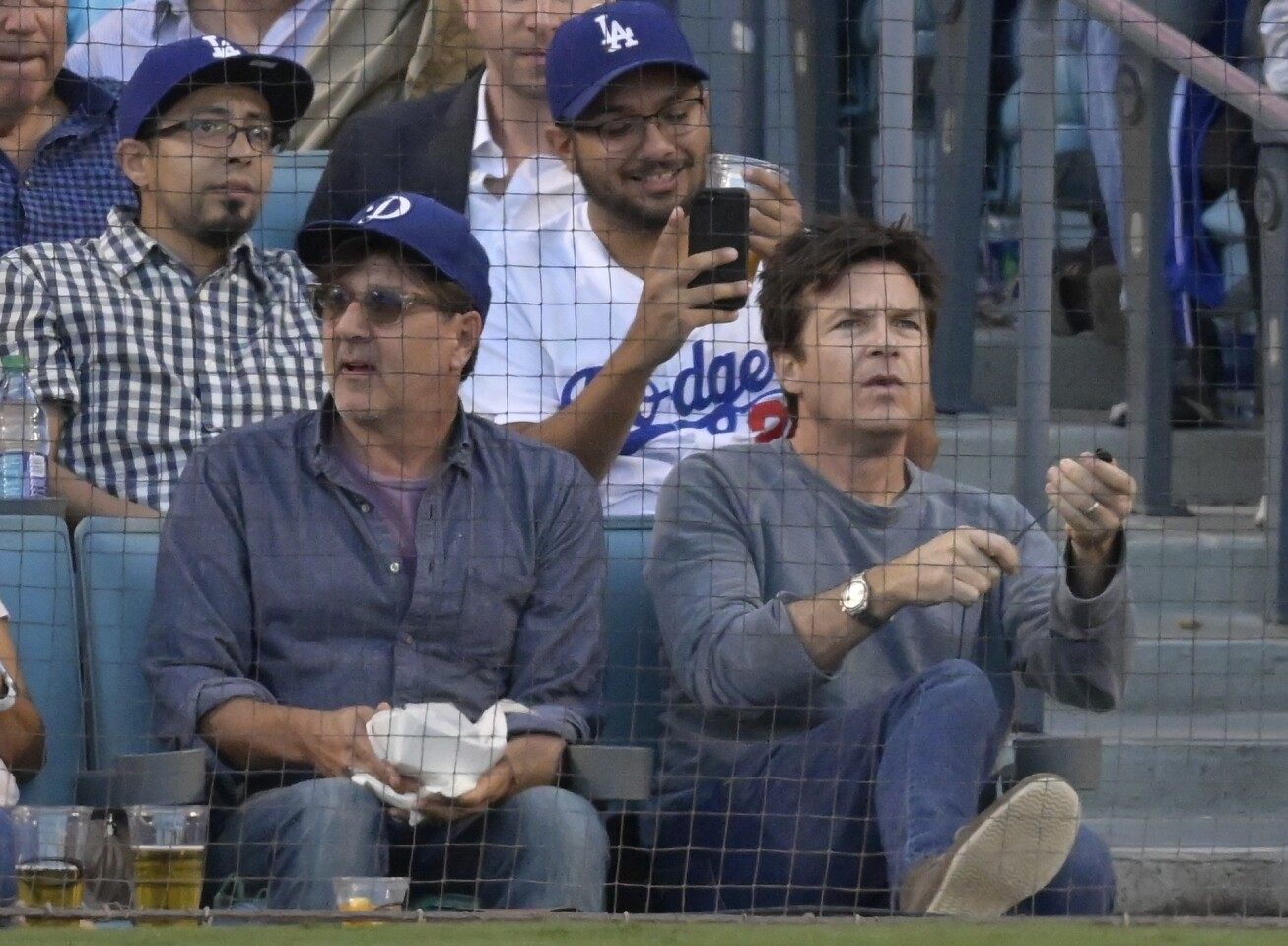 Actor Jason Bateman watches during the third inning of Game 3 of the National League Championship Series baseball game between the Milwaukee Brewers and the Los Angeles Dodgers Monday, Oct. 15, 2018, in Los Angeles. (AP Photo/Mark J. Terrill)