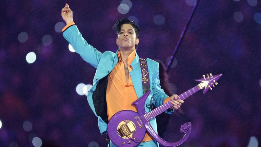 Prince performs during the halftime show at the Super Bowl XLI football game in 2007 at Dolphin Stadium in Miami.