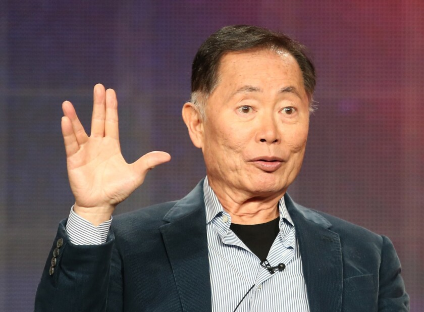 """George Takei, author of """"They Called Us Enemy,"""" gives the Vulcan salute."""