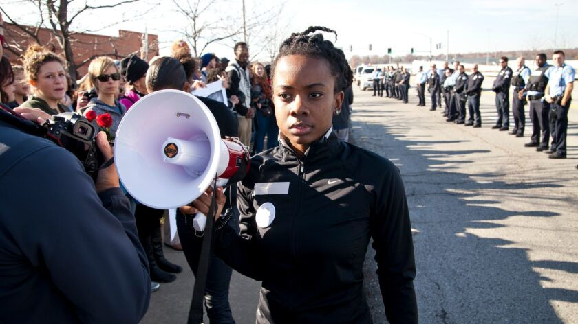 Activist Brittany Ferrell and crowd of protesters in WHOSE STREETS?, a Magnolia Pictures release. Ph