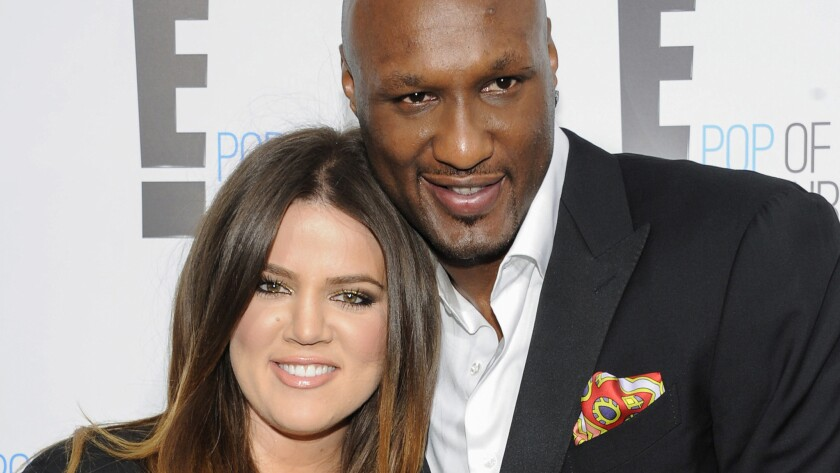 Lamar Odom, shown in 2012 with Khloe Kardashian, has reportedly taken his first steps without assistance since his October overdose.