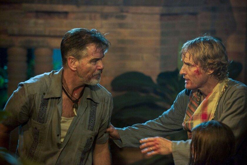 "Pierce Brosnan, left, and Owen Wilson in a scene from ""No Escape."""