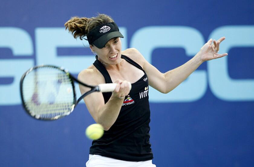 Martina Hingis returns a shot against Anne Keothavong during a World Team Tennis match in Newport Beach.