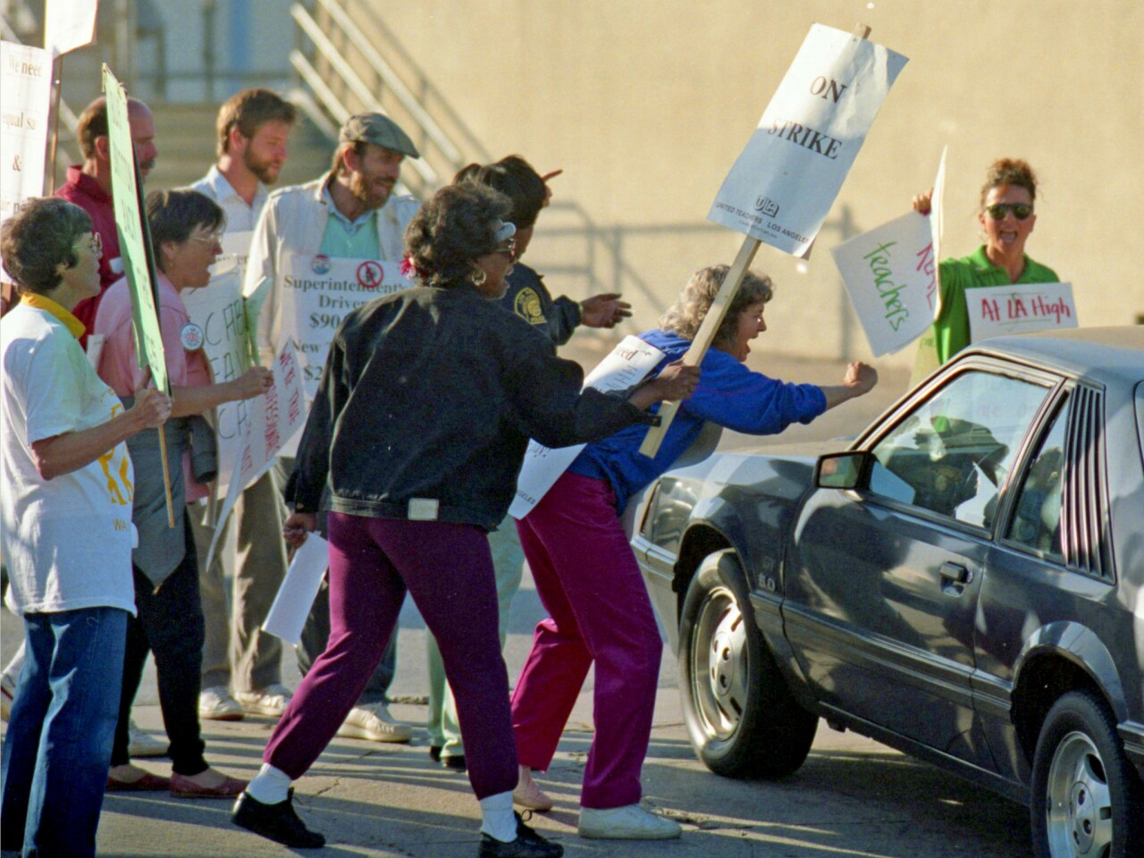 May 23, 1989: Striking teachers challenge car entering parking lot at Los Angeles High School during 1989 LAUSD teachers' strike.