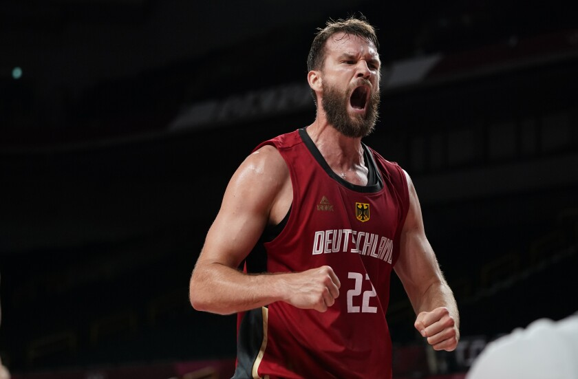 Germany's Danilo Barthel (22) celebrates after making a basket and was fouled during men's basketball preliminary round game against Nigeria at the 2020 Summer Olympics, Wednesday, July 28, 2021, in Saitama, Japan. (AP Photo/Charlie Neibergall)