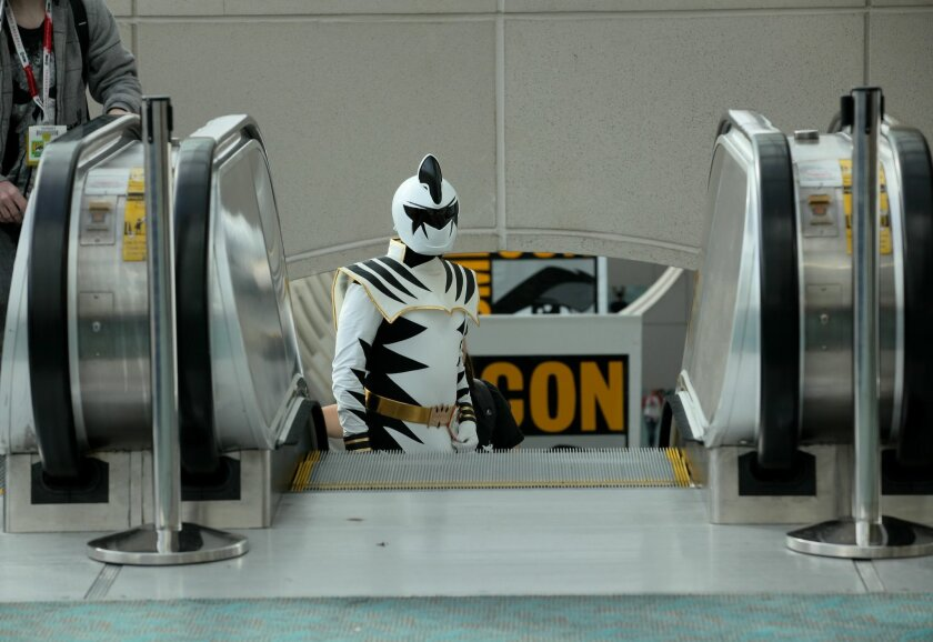 At Day One of Comic-Con 2015, people flooded up the escalators in the morning to line up for their first chosen exhibit hall of the day.