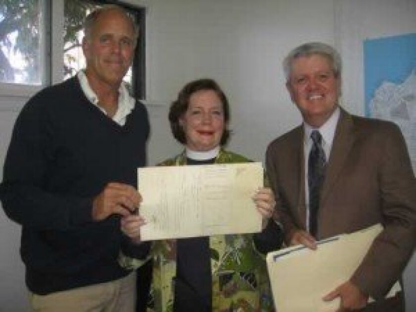 la Jolla historical society member Tom Grunow (left), Rev. eleanor ellsworth of st. James by-the-sea church, and historical society executive Director heath Fox at the presentation of the original deeds to the church. Ashley Mackin