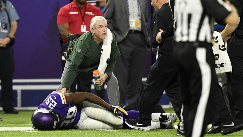 Xavier Rhodes of the Minnesota Vikings lies on the field after sustaining an injury in the fourth quarter against the Green Bay Packers.
