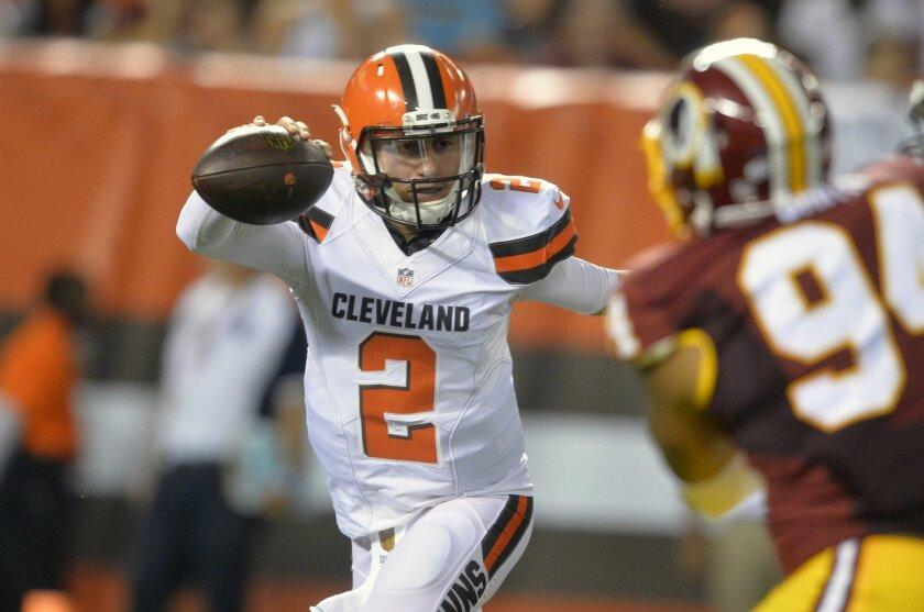 FILE - In this Thursday, Aug. 13, 2015 file photo, Cleveland Browns quarterback Johnny Manziel (2) scrambles during an NFL preseason football game against the Washington Redskins in Cleveland. Manziel will start Cleveland's home opener Sunday, Sept. 20, 2015 against Tennessee — and fellow Heisman Trophy winner Marcus Mariota — because Josh McCown remains out with a concussion sustained when he was hit while trying to dive into the end zone on the opening drive last week in New York. (AP Photo/David Richard, File)