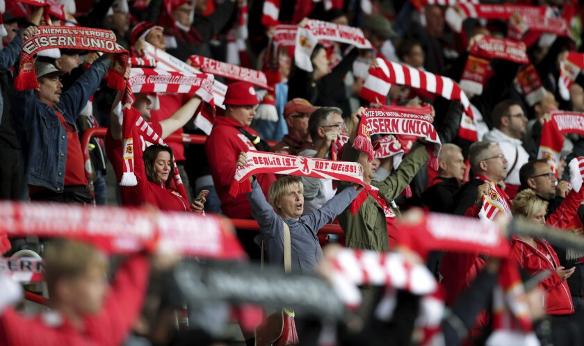 Supporters sing the club's anthem prior to a friendly soccer match between the German first division, Bundesliga, team 1. FC Union Berlin and the second division team 1. FC Nuremberg in Berlin, Germany, Saturday, Sept. 5, 2020. (AP Photo/Michael Sohn)