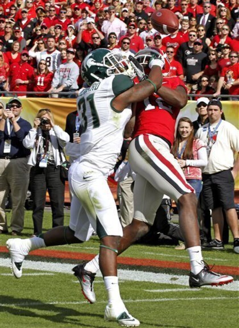 Michigan State cornerback Darqueze Dennard (31) knocks the ball away from Georgia wide receiver Tavarres King (12) during the first quarter of the Outback Bowl NCAA college football game on Monday, Jan. 2, 2012, in Tampa, Fla. (AP Photo/Chris O'Meara)
