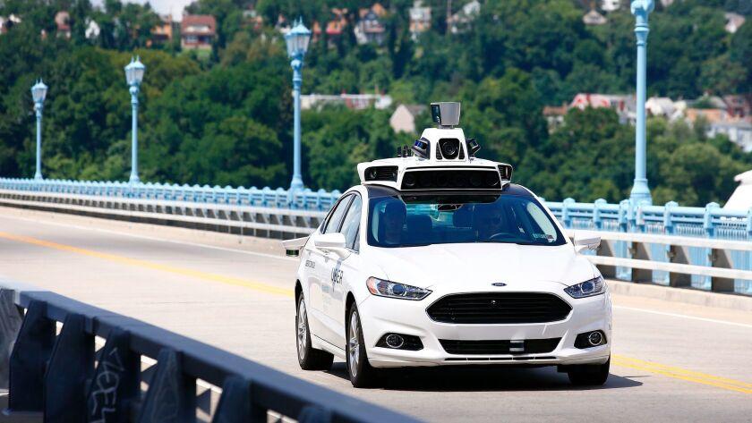 An autonomous Uber test car on a bridge in Pittsburgh.