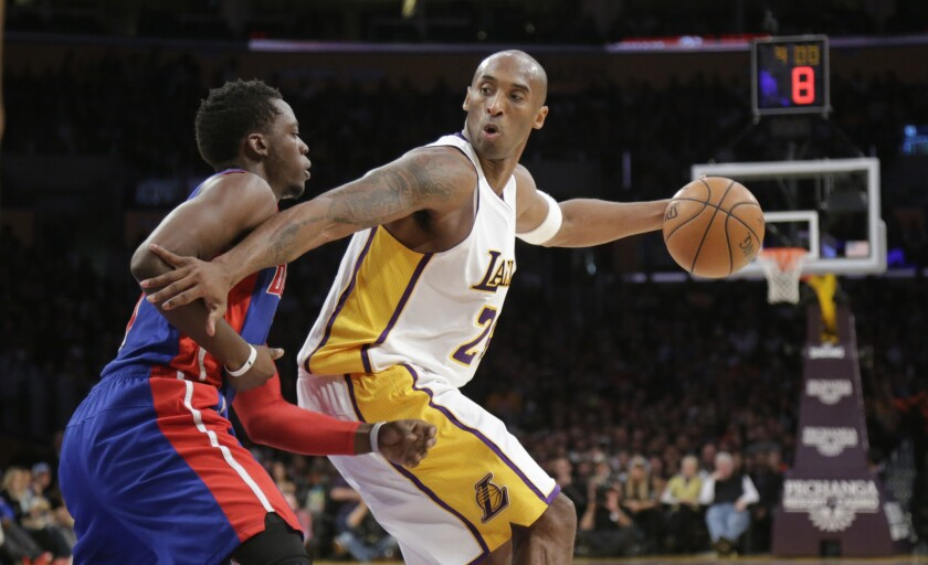 Lakers guard Kobe Bryant working against Pistons forward Stanley Johnson in the first half.
