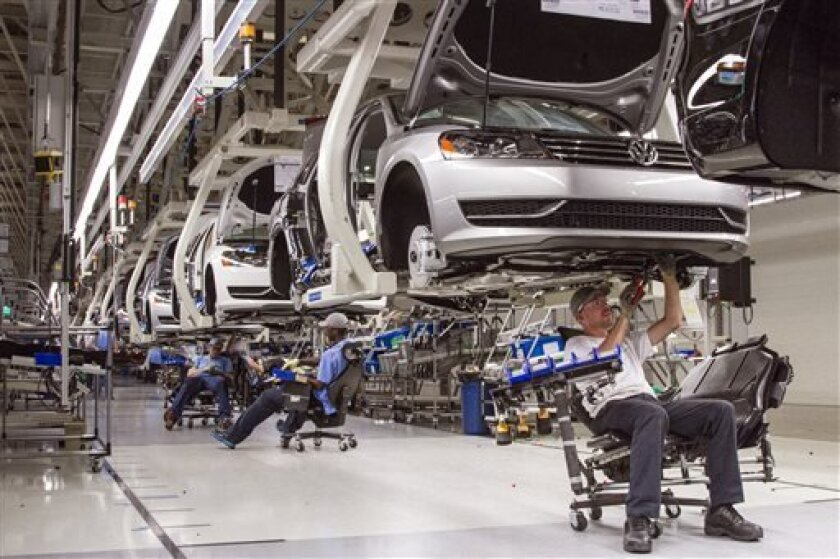In this July 12, 2013, photo, employees at the Volkswagen plant in Chattanooga, Tenn., work on the assembly of a Passat sedan. Efforts by the United Auto Worker to unionize the plant have raised concerns among southern Republicans, who worry that the move would hurt the region's ability to lure foreign automakers in the future. (AP Photo/Erik Schelzig)