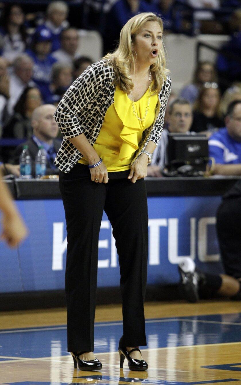 Florida head coach Amanda Butler yells to her team during the second half of an NCAA college basketball game against Kentucky, Sunday, Jan. 5, 2014, in Lexington, Ky. Florida won 83-73. (AP Photo/James Crisp)