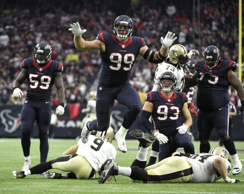 Houston Texans defensive end J.J. Watt (99) leaps after sacking New Orleans Saints quarterback Drew Brees (9) during the third quarter of an NFL football game, Sunday, Nov. 29, 2015, in Houston. (AP Photo/Eric Christian Smith)