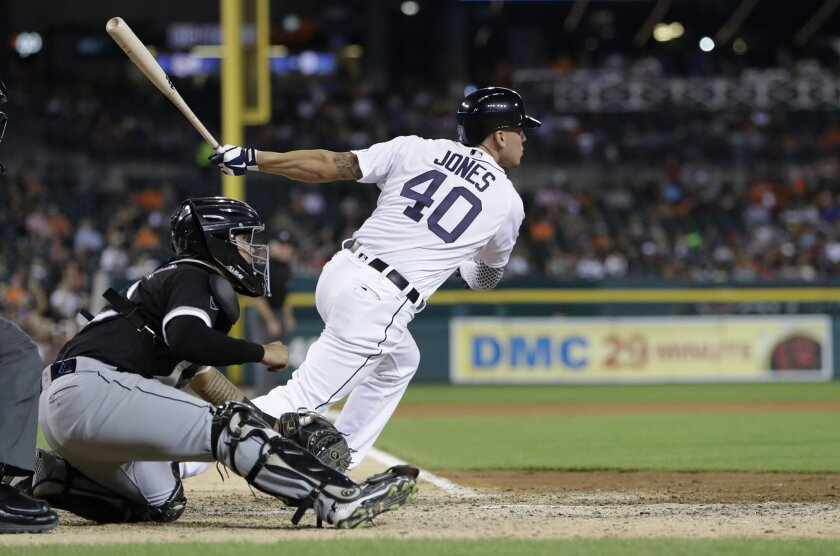 Detroit Tigers' JaCoby Jones watches as he hits an RBI double during the sixth inning of a baseball game against the Chicago White Sox, Tuesday, Aug. 30, 2016, in Detroit. The hit was Jones' first hit as a Tiger. (AP Photo/Carlos Osorio)