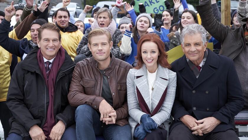 "Joe Theismann, left, Trevor Donovan, Lindy Booth and Ed Marinaro in the new TV movie ""Snowcoming"" on Hallmark."