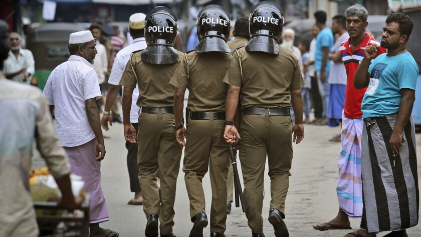 FILE- In this Friday, April 26, 2019 file photo, Sri Lankan policemen patrol a Muslim neighborhood b