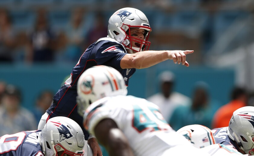 Patriots quarterback Tom Brady calls out a play against the Dolphins.