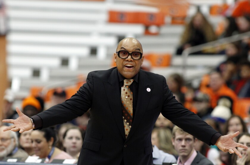 FILE - In this Feb. 9, 2020, file photo, Syracuse head coach Quentin Hillsman yells to his players in the first quarter of an NCAA college basketball game against Louisville in Syracuse, The Syracuse women's basketball coach who resigned after players accused him of bullying has been hired by a professional club in Spain. Leganés in Madrid announced the signing of Quentin Hillsman a month after he stepped down amid an external review of his program. He left Syracuse after 15 seasons in charge when he was accused by former players and staff of threats, bullying and unwanted physical contact. (AP Photo/Nick Lisi, File)