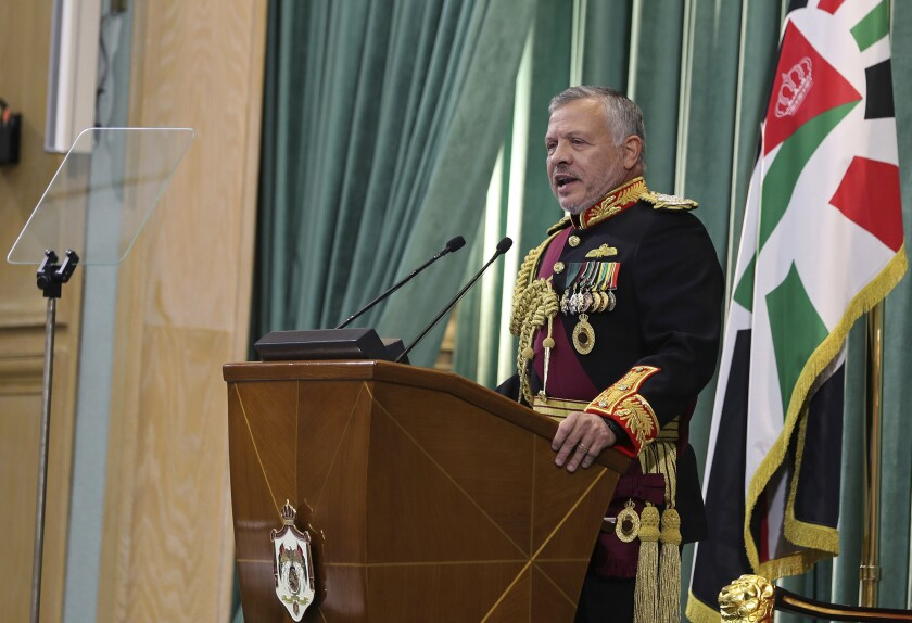 """Jordan's King Abdullah II, speaks to Parliament in Amman, Jordan, Sunday, Nov. 10, 2019. The king announced """"full sovereignty"""" over two pieces of land leased by Israel, ending a 25-year arrangement spelled out in the countries' landmark peace agreement. King Abdullah II said Sunday that Jordan would end the """"annex of the two areas, Ghumar and Al-Baqoura, in the peace treaty and impose our full sovereignty on every inch of them."""" (AP Photo/Raad Adayleh)"""