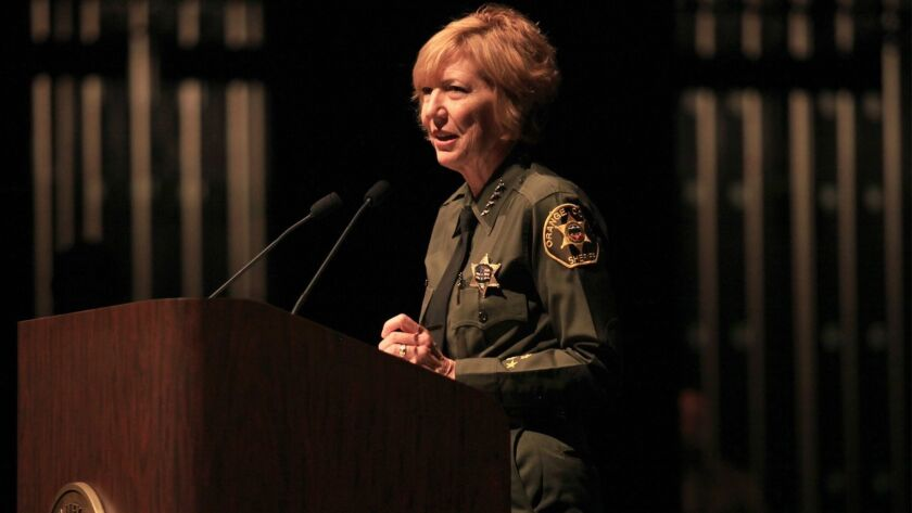 Orange County Sheriff Sandra Hutchens speaks at Irvine Valley College in 2014. A Sheriff's Department employee revealed this week that the agency had improperly recorded more than 1,000 inmate-attorney phone calls since 2015.