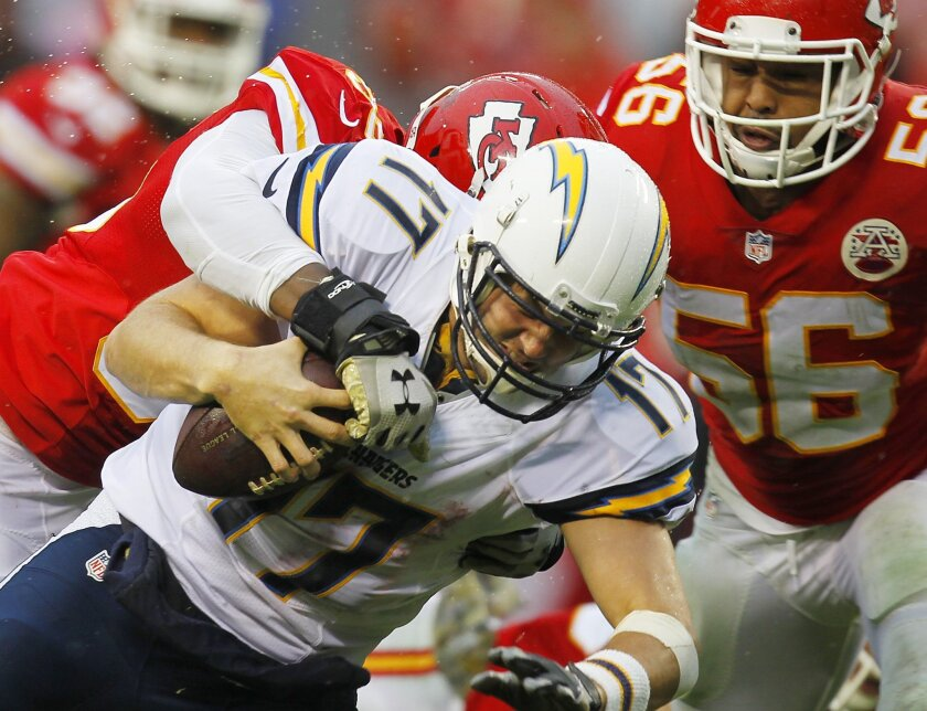 KANSAS CITY, MO -DEC. 9, 2015 - Chargers Philip Rivers is hit by Chiefs Dee Ford in the 3rd quarter. The Chargers loss 10-3. ( K.C. Alfred/ San Diego Union-Tribune)