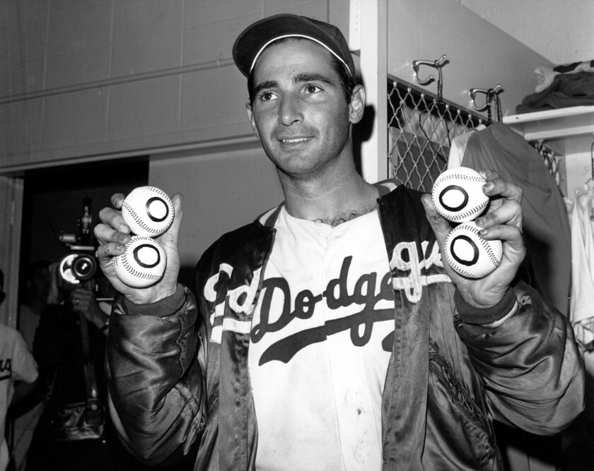 Fifty years ago, Dodgers' Sandy Koufax and Don Drysdale engaged in a salary holdout that would help change baseball forever